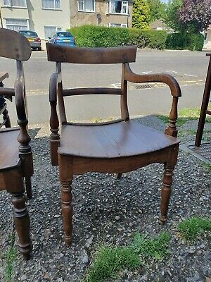 A wonderful pair of quality Antique Regency Georgian elbow library chairs.