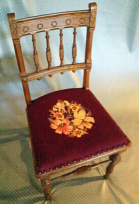 Antique carved-back spindle chair with petit-point seat