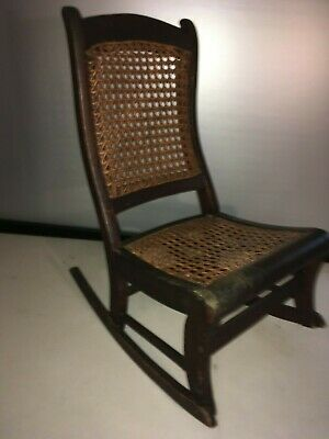 Antique child's caned rocking chair
