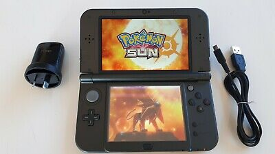 NEW VERSION Nintendo 3DS XL with a game,
