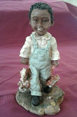 Vintage African American figurine black Americana boy walking with toy and books