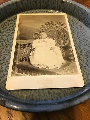 antique cabinet photo Baby in white dress in Ornate Wicker chair Hidden Mother?