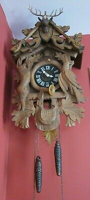 Hunter Black Forest Cuckoo Clock German Stags head Guns,Rabbit, old carved wood
