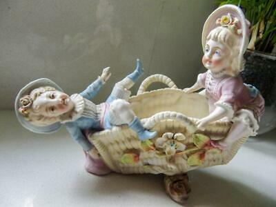 Antique Bisque Figurine of 2 Children Playing on a Basket Seesaw - C1980's