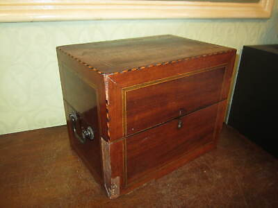 An old Victorian inlaid box with brass handles