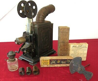 Early 20th Century Hank Cranked Tin Film Projector With Rare Film. German?