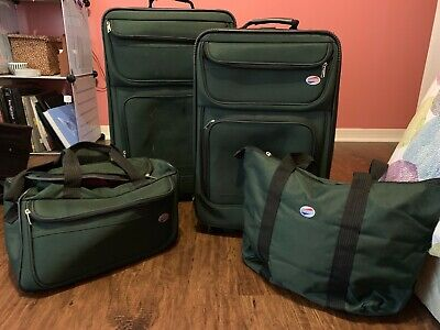 4 piece American Tourister luggage set on wheels