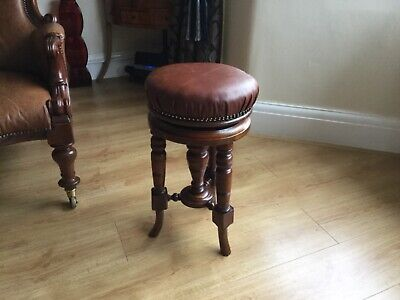 antique victorian  adjustable piano stool turned legs  and leather seat