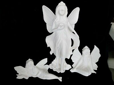 Three fairies.  Unpainted ceramic bisque for you to paint.