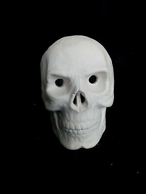 small human skull.  can be an incense smoker. Ceramic bisque to paint.