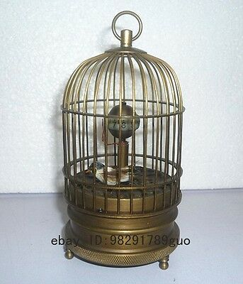 Eximious brass birdcage machine clock with bird inside 5.5""