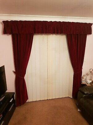 2 pairs of burgundy velvet curtains with pelmets and tie backs