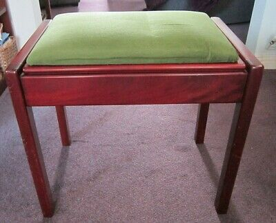 Lidded mahogany piano stool with green velour covered seat