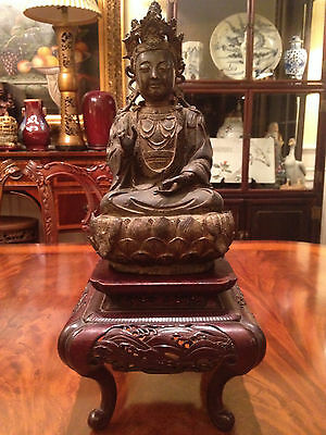 A Rare and Important Early Chinese Bronze Guanyin Statue with Wooden Stand.
