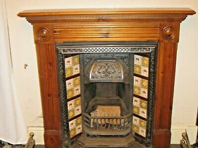 Victorian cast iron fire place, original tiles, Wooden surround and brass fender
