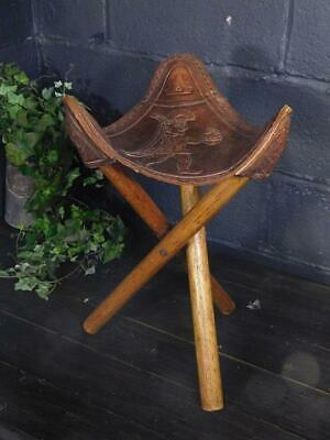 An Unusual Antique Folk Art Embossed Leather Tripod Stool