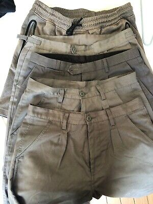 Five pairs of grey Medium shorts suitable for High school