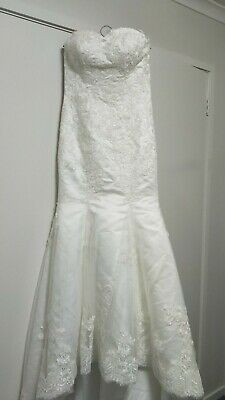 Strapless Ivory Lace Wedding Dress Mermaid with train. Size 8. Lace up back.