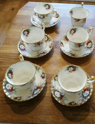 "Royal Albert Bone China ""Celebration"" 5 Piece cup & saucer and 1 free cup"