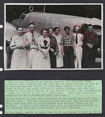 Old photograph of Amelia Earhart standing by her plane at Lae New Guinea 1937