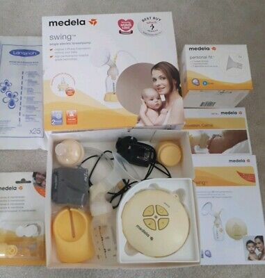 Medela swing single electric breast pump with extras