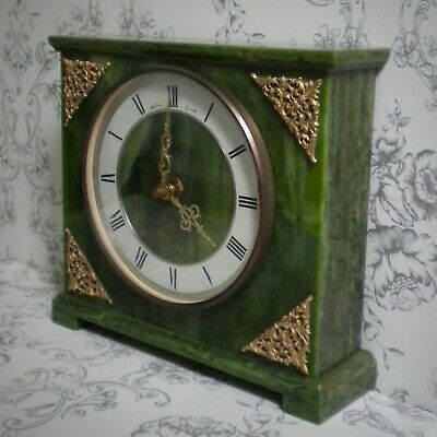 Vintage Bentima Art Deco mantle clock. Green marble with ornate gold detail.