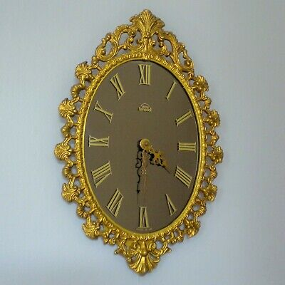 Vintage Smiths clock in Rococo style ornate decorative gold gilt Castcraft frame
