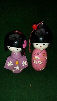 Pair Of Hand Carved And Painted Wooden Kokeshi Dolls With Hanging Loop
