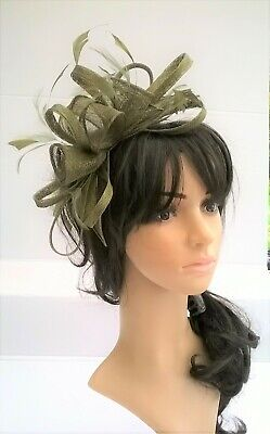 Olive green Feather Fascinator.rosette on a headband..for wedding races.new