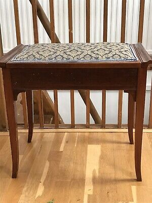 Pretty Piano Stool With Storage In The Seat.