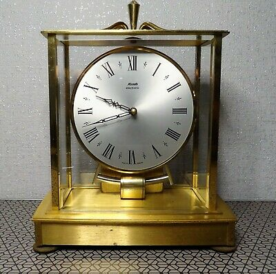 Kundo electronic clock with brass and glass case in working order. German made.