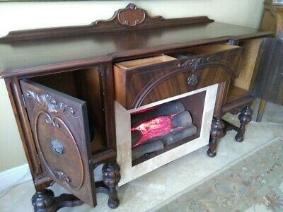 Antique buffet with electric fireplace