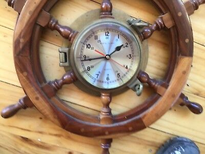 Clock for collector heavy timber wheel and brass clock many decades old ,nice!