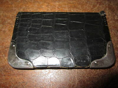 An antique leather wallet with hallmarked silver corners - crocodile