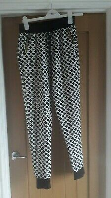 Ladies/Girls Size 8 Black And White Trousers