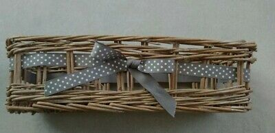 Wicker basket with bow detail