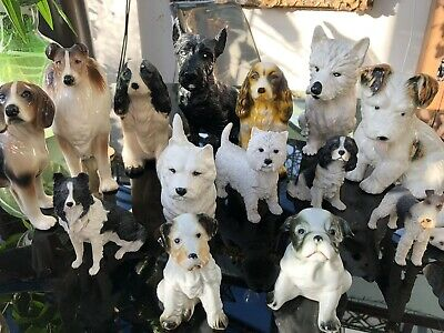 A large collection of 18 Antique Dogs