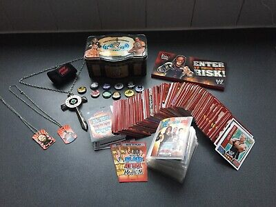 WWE BUNDLE, TOPPS ATTAX CARDS, BADGES, NECKLACES, WWE TIN & Much More.