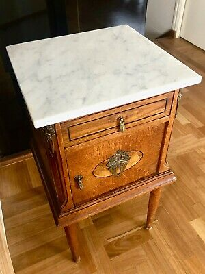 Pair of French oak, ormolubed side tables with white marble tops, circa 1920