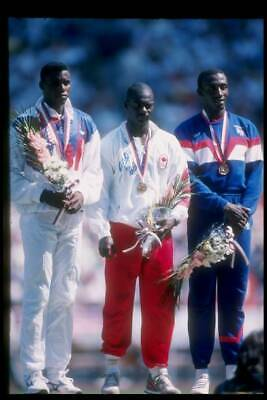 1988 SEOUL OLYMPICS PHOTO Carl Lewis Stands With Ben Johnson