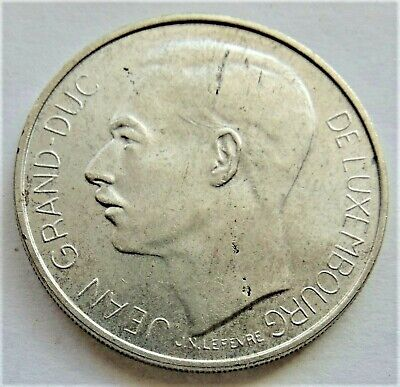 1964 LUXEMBOURG Charlotte, silver 100 Francs, grading UNCIRCULATED.