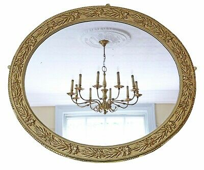 Antique large oval mid 19th Century Victorian gilt overmantle wall mirror