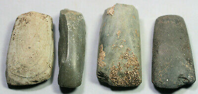 Four stone axes or tool fragments - possibly prehistoric