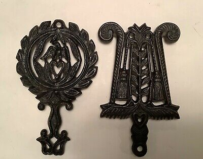 Two Wilton Small Black Cast Iron Trivets - Wreath with Bird & Lyre with Tassels