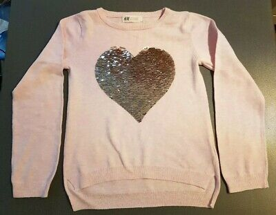 H&M pale pink jumper with reversible sequin heart. Age 6-8. Good condition.