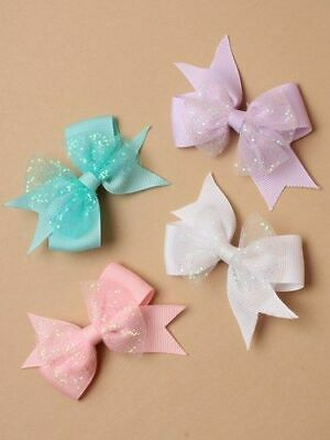 Layered grosgrain ribbon hair bow with glitter net detail on a fork clip.8cm