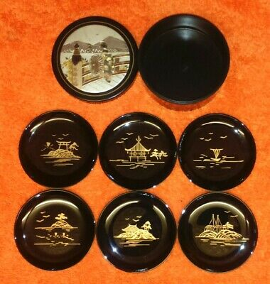 Vintage Japanese Black Laquered 7 Piece Coaster Set Hand Painted..