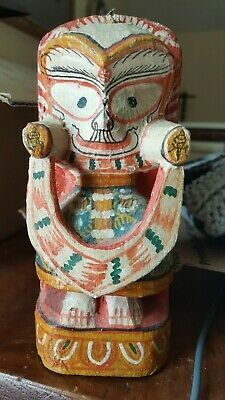 Old handmade Brother of Jagannath figure wood and painted canvas. Soft colors.