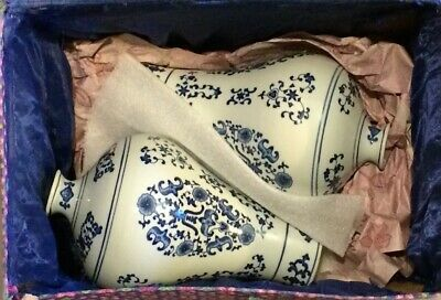 Pair of Chinese plum vases, handpainted blue on white porcelain, with box