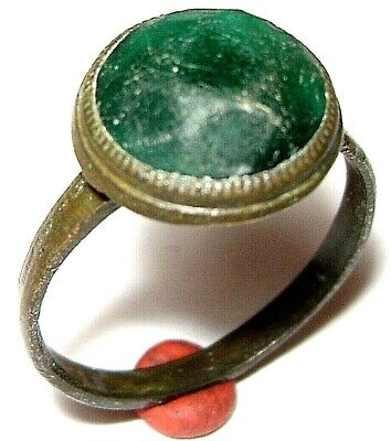 Ancient Medieval bronze finger ring with green stone.